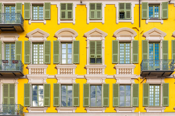 Foto op Plexiglas Nice Nice in France, colorful facade, with typical murals windows and green shutters, place Garibaldi, detail