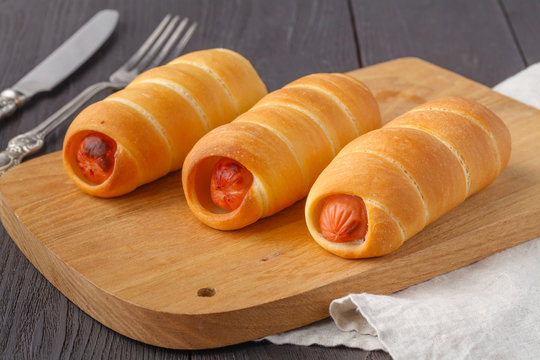 Home made pigs in a blanket. Sausages rolled in croissant dough, baked