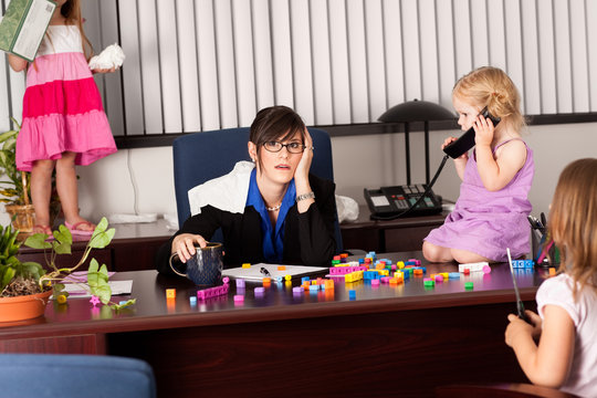 Stressed Businesswoman with Children in Office - Working Mom