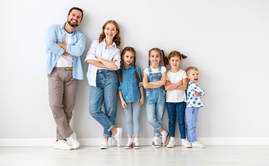 large family mother father and children sons and daughters on white background