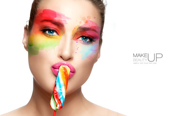 Beautiful woman with rainbow colored makeup. Fashion makeup and cosmetics concept. Fine art beauty portrait