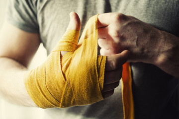 Boxer's yellow bandage on his hand, close-up