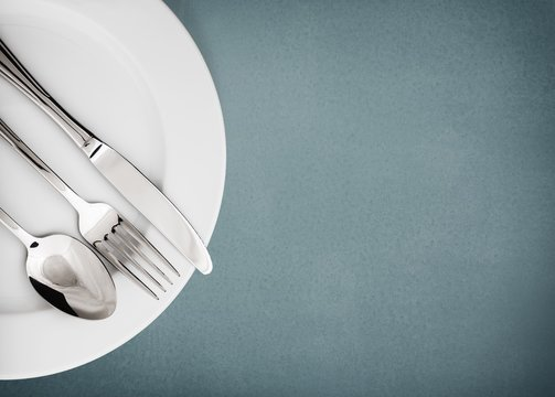 Silverware. Fork, spoon and knife isolated on white