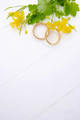 Wild flowers and wedding rings with copy space
