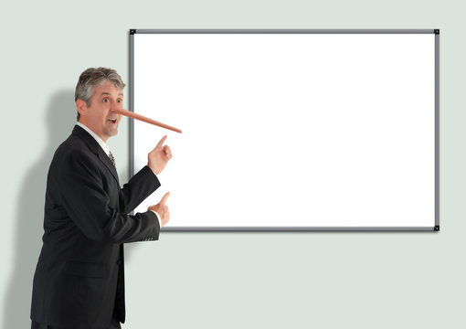 Lying dishonest businessman with growing Pinocchio nose pointing to blank white board