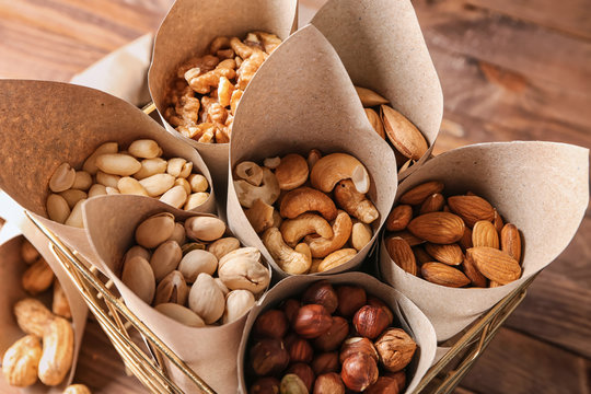 Basket with assortment of tasty nuts on table