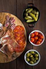 Selection of charcuterie and tapas dishes on a wooden table