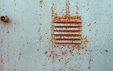 Rusty perforated air vents on steel door in switchboard painted white which became orange from rust in some places. Texture of cracked white paint Wall mural