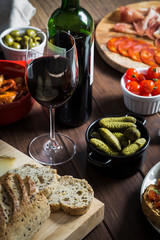 Wine and tapas dishes on a wooden table