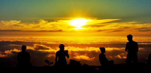 Magical sunset and silhouettes of people at Table Mountain, South Africa