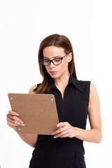 Young businesswoman reviewing checklist isolated