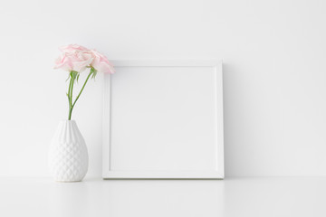 White square frame mockup with soft pink roses in a vase.