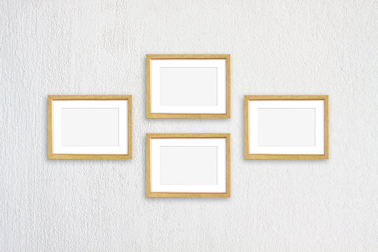 Golden frames collage, four realistic  frameworks on white textured wall, interior decor mockup
