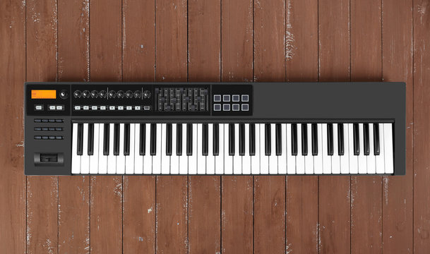 Musical instrument - Black MIDI keyboard wood background