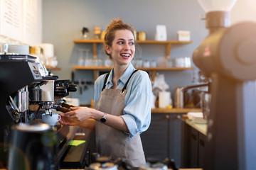Fototapeta Woman working in coffee shop obraz