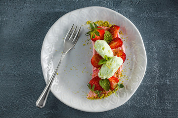 Strawberry dessert with mint.