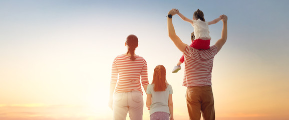 happy family at sunset. Wall mural