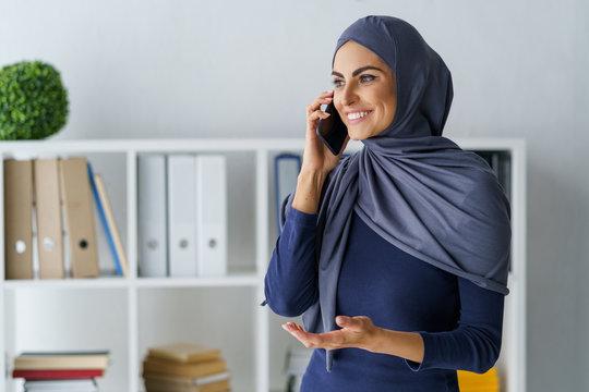 Muslim woman talking on phone