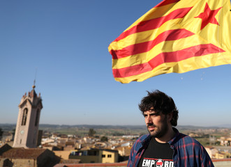Mayor of Verges, Ignasi Sabater Poch, poses for a picture in front of a pro-independence Catalan flag in Verges