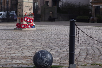 Memorial monument on a cobbled town square
