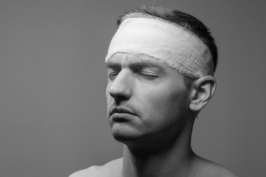 bandaged head, black and white photo
