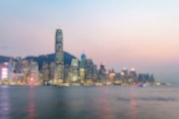 Fototapete - Out of fucus of Hong Kong skyline on the evening seen from Kowloon, Hong Kong, China.