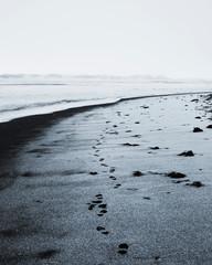 footprints on the black sand