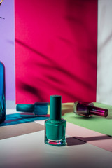 Set of different nail polish, on colorful background