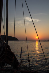 Sailing boat mast and rigging in the sunset in the Andaman sea in Thailand