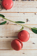 Pink macaroons , on light wooden table