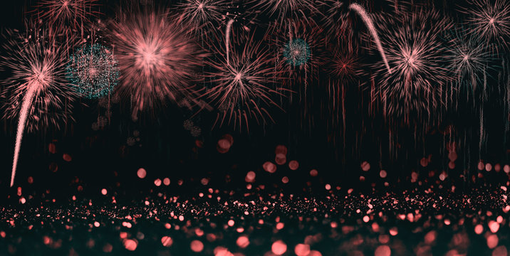 Abstract celebration background with colorful fireworks and bokeh lights.