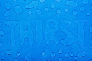 """The word """"thirst"""" is written with water droplets and water droplets on a blue smooth surface. Top view"""