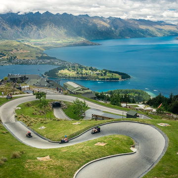 Luge track with mountains in the background at Queenstown Skyline site, New Zealand.
