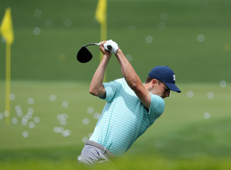 Jordan Spieth of the U.S. hits balls on the practice range during the second day of practice for the 2019 Masters golf tournament at the Augusta National Golf Club in Augusta, Georgia, U.S.
