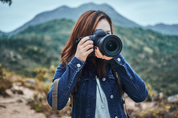 Woman is taking a photo shoot at nature
