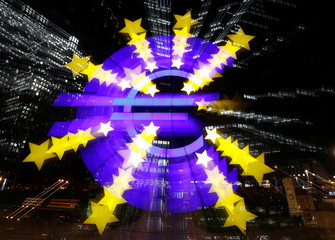 The euro sign is photographed in front of the former head quarter of the European Central Bank in Frankfurt