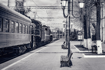 Steam train departs from the railway station. Wall mural