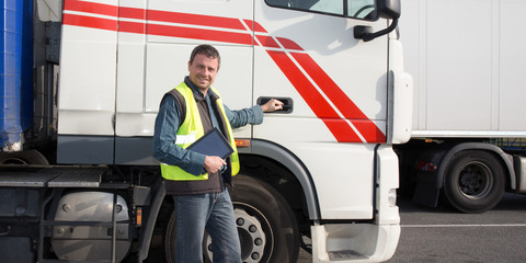 happy trucks driver in front of container delivery truck