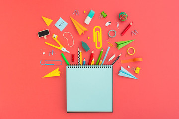 Creative flat lay with school supplies around blank notebook for copy space.. Top view. Wall mural