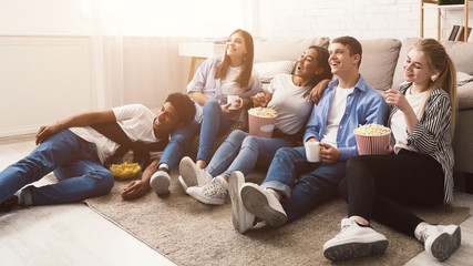 Happy friends watching comedy movie at home Wall mural
