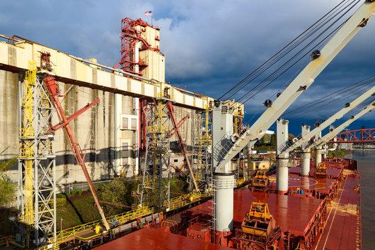 Bulk carrier alongside grain terminal at Columbia river in Portland, Oregon