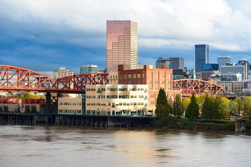 Day view of Portland, Oregon downtown from Willamette river bank