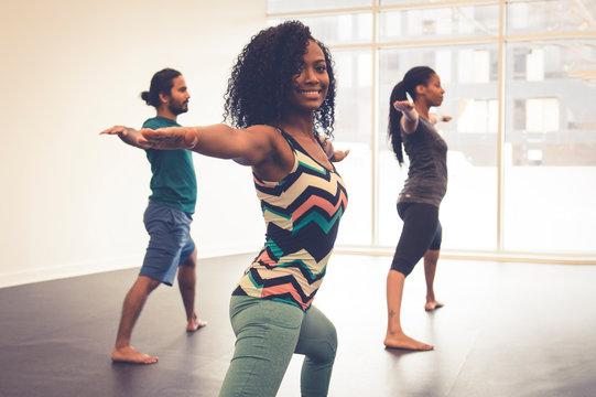 People practicing yoga indoors