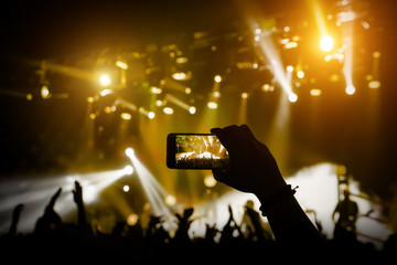 Filming a concert on mobile phone camera, yellow light