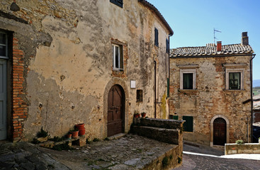 typical alley with old colorful buildings in San casciano dei Bagni, Tuscany, Italy