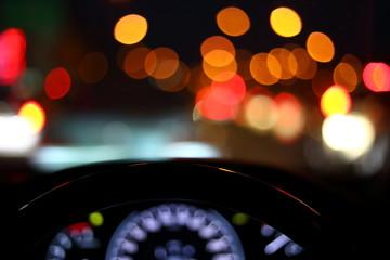 Fotomurales - black steering wheel inside car drive in night city street