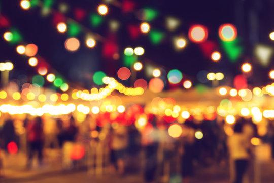 blur bokeh night festival warm light cool chill party in walking street.