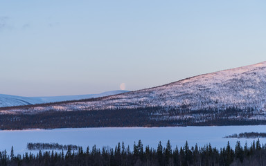 Fotomurales - Moon at the horizon near Aktse in Swedish Lapland.