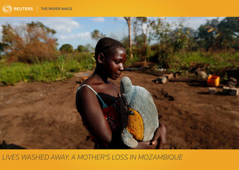 The Wider Image: Lives washed away: A mother's loss in Mozambique
