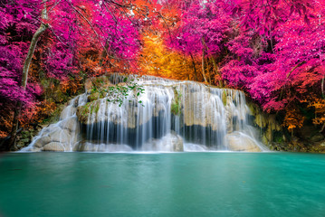 Amazing in nature, beautiful waterfall at colorful autumn forest in fall season